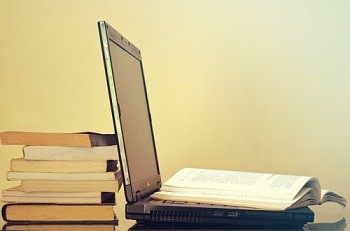 Books & Laptop - Homeworking tips from Orderly Office and Home